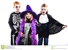 three cute child dressed the halloween costumes witch skeleton