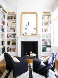 fireplace bookshelf ideas gold mirror modern space stone mantel