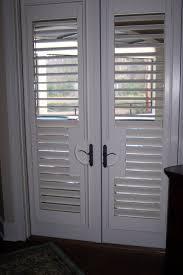 Patio Door Shutters Patio Ideas Patio Door Shutter With White Two Panel Doors And