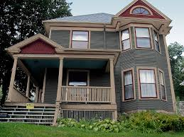 victorian home designs grey paint exterior color with beige porch railing and stylish