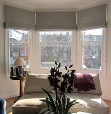 grey window blinds in the bay windows whiten yellowed window