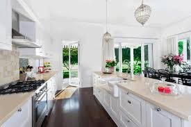 dining room bay window kitchen galley layout black glossy countertop dark wooden dining