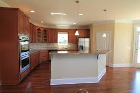 gripping l shaped kitchen with island and corner pantry also