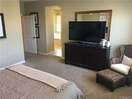 conveniently located upstairs laundry room with extra shelving and