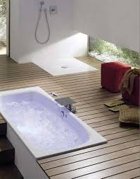 white drop in bathtub with wood flooring idea also metal