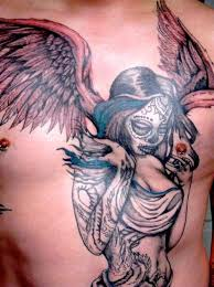 chest tattoo of fallen angel only tattoos