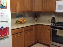 white kitchen cabinets yes or no backsplash or no backsplash