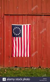 13 Stars In The United States Flag Close Up United States Flag On A Red Vintage Barn Monroe Stock