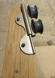 high quality sliding ladder hardware fitted to custom made oak ladder