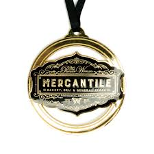 black and gold enamel metal ornament the pioneer mercantile