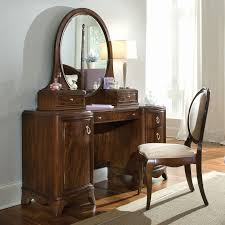 wooden bedroom vanity furniture with large oval mirror also table