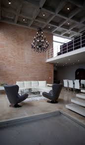 Interior Spacious Living Room With Exposed Brick Wall Behind The