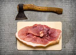 meat cutting table tops a piece of raw pork with a hatchet for meat cutting stock image