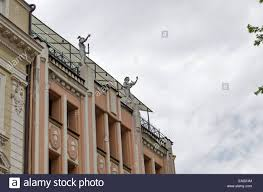 renovate old house with human figure of the roof plovdiv town