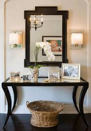 entrance table and mirror chic foyer with black mirrored top console table with wicker