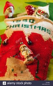 vintage 1950 hand knit christmas stocking and toys stock photo