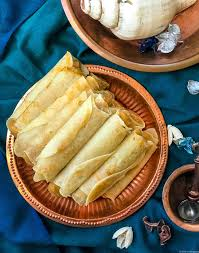cuisine crepe patishapta pithey bengali crepe with coconut filling for