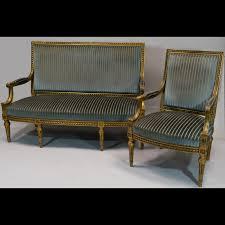 un canapé quatre fauteuils et un canapé en bois doré 140708 expertissim