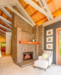 red brick fireplace living room transitional with vaulted ceiling