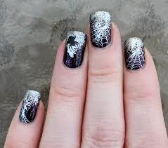 halloween nail art orange tip with black underlining white polish