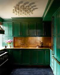 dark green kitchen cabinets copper backsplash patinated handles emerald hand painted panels