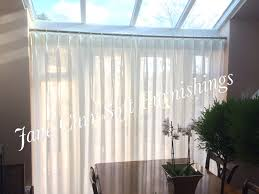 double pinch pleat headed voile curtains on recess fitted curtain