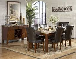 beautiful marble top dining table and modern chandleholders add
