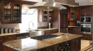 large dark brown wooden kitchen cabinets and island having marble