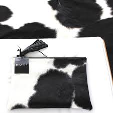 mooi jem in black and white solid leather cow hide bag clutch