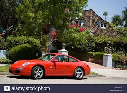 porsche driveway red porsche parked outside house in beverly hills california
