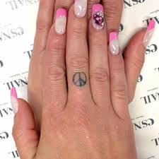 finger tattoo peace chanel west coast s 7 tattoos meanings steal her style