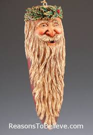 father christmas ornament with holly carved into the hat amazing