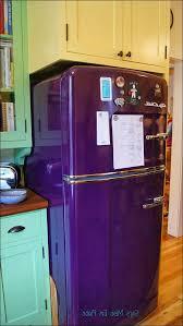 kitchen orange kitchen appliances retro looking microwave stove