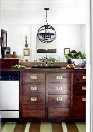 hardware for kitchen cabinets and drawers love the furniture looking cabinets the mix of rustic and shiny