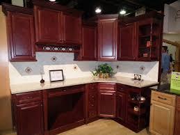 dark cherry kitchen cabinets kitchen backsplash cherry cabinets cream counter tops dark cherry