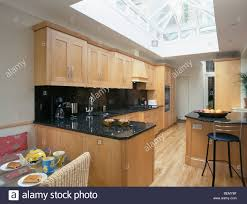 large modern kitchen large skylight in modern kitchen extension with wooden flooring