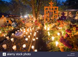 a candle lit grave dia de muertos day of the dead in a cemetery