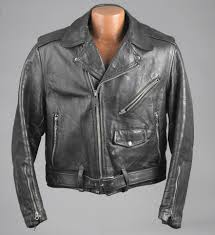 armored leather motorcycle jacket worn to be wild explores cultural legacy of the motorcycle jacket