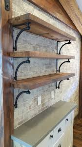 open shelves with cast iron brackets on newly installed brick wall
