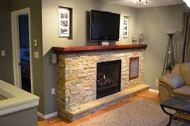 furniture built in stone fireplace with tv stand added floor lamp