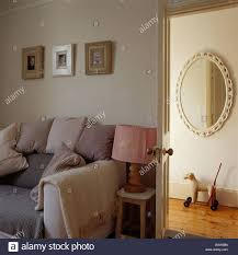 Beige Sofa Living Room by Living Room With Beige Sofa Piled With Cushions Beside Open Door