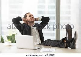 Legs On Desk Successful Man Sitting Hands Behind Head In Office Stock Photo