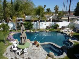 On The Rocks Garden Grove Swimming Pool Rock Style Landscaping Ideas White Fence Backyard