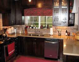 cream grenite countertops added by dark brown wooden kitchen