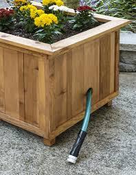 diy pallet wood hose holder with planter diycandy com