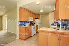 blue maple cabinets kitchen kitchen interior maple cabinets and back splash trim stock photo image now