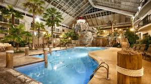 indoor tropical atrium and pool picture of best western plus