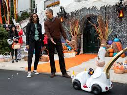 file barack and michelle obama react to a child in a pope costume