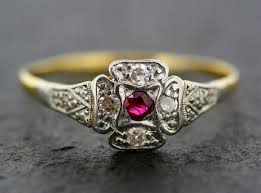 this sweet little antique art deco ring has a tiny bright red