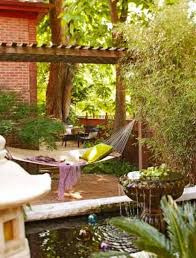 backyard oasis with fountain and pond and hammock creating your